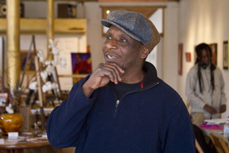 Artist William Burton Jr. looks around in his former gallery in North City's Crown Square.