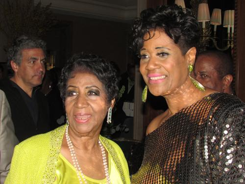 Denise Thimes with Aretha Franklin (left) at Franklin's 72nd birthday celebration.