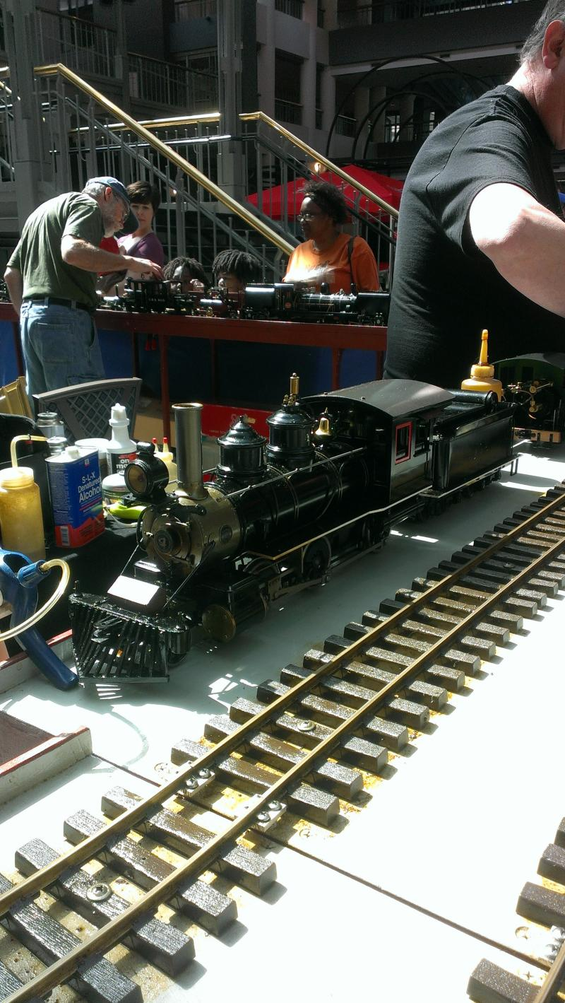 A close-up of a G-scale model train that runs on steam from the Midwest Live Steamers.