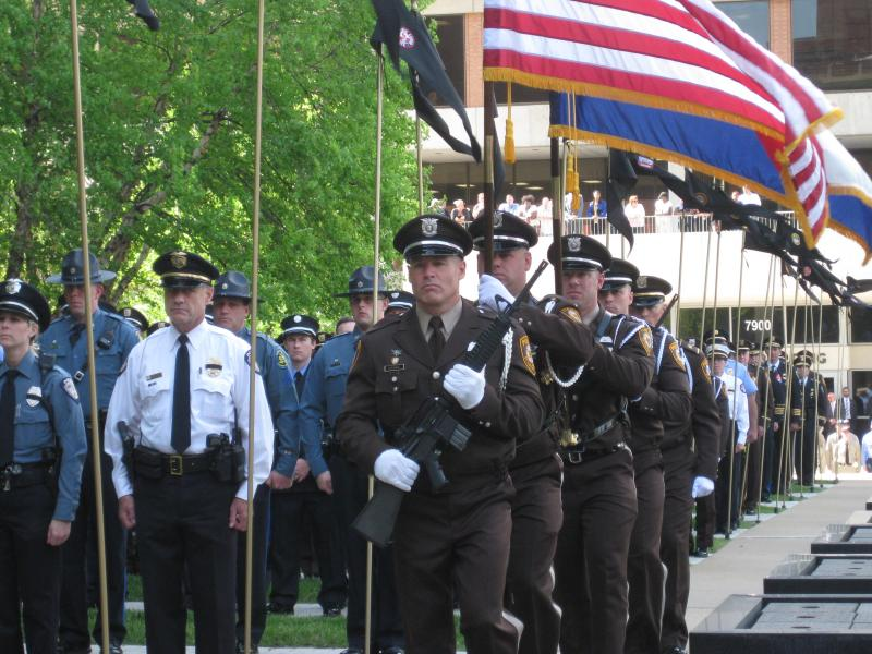 The St. Louis County Police honor guard presents the colors at a memorial ceremony on May 9, 2014.