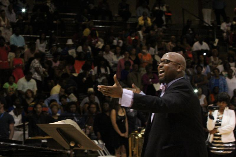 Choir Director, Bernard Long, directs the Normandy High School choir during the school's graduation ceremony.