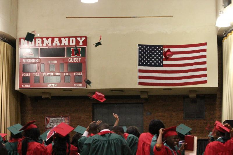 Normandy High School graduates toss their hats.