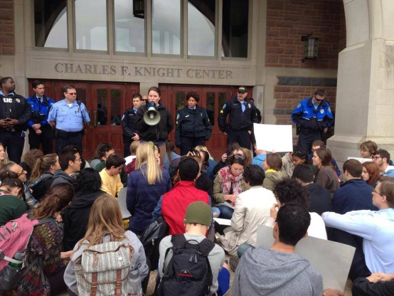 Students at Washington University protest outside a  Board of Trustees meeting on Friday. Seven students who tried to enter the building were arrested.