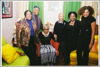 In this 2011 photo taken in Harlem, Maya Angelou is seated and Eugene Redmond is at her right.