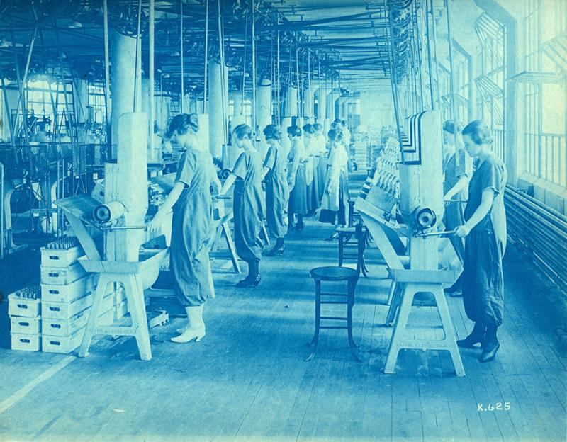 1918: A cyanotype of women assembling detonators at Wagner Electric Company. Local munitions plants hired thousands of women to fill vacancies during World War I.