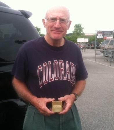Mike St. Vrain holding the stopwatch his father once owned. Stasha Lanigan-Wyman and St. Vrain met in a grocery store parking lot.