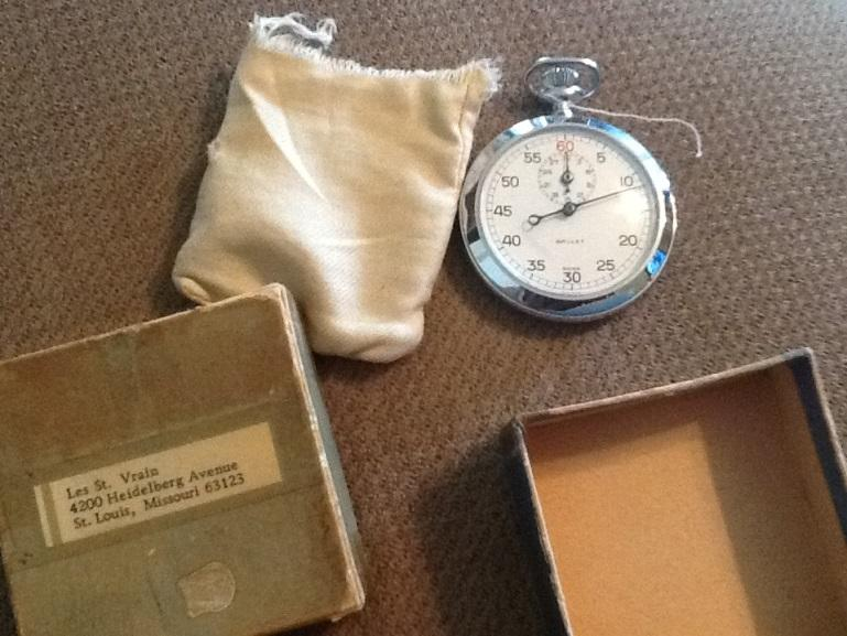 A silver-plated stopwatch once owned by Les St. Vrain and stolen was returned to his son earlier this week.