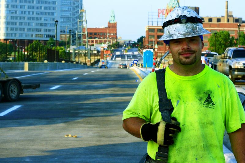Redoing the Grand Boulevard Bridge filled just one piece of the city's transportations needs. Derek AuBuchon was foreman of a crew that painted the bridge's four metal towers.