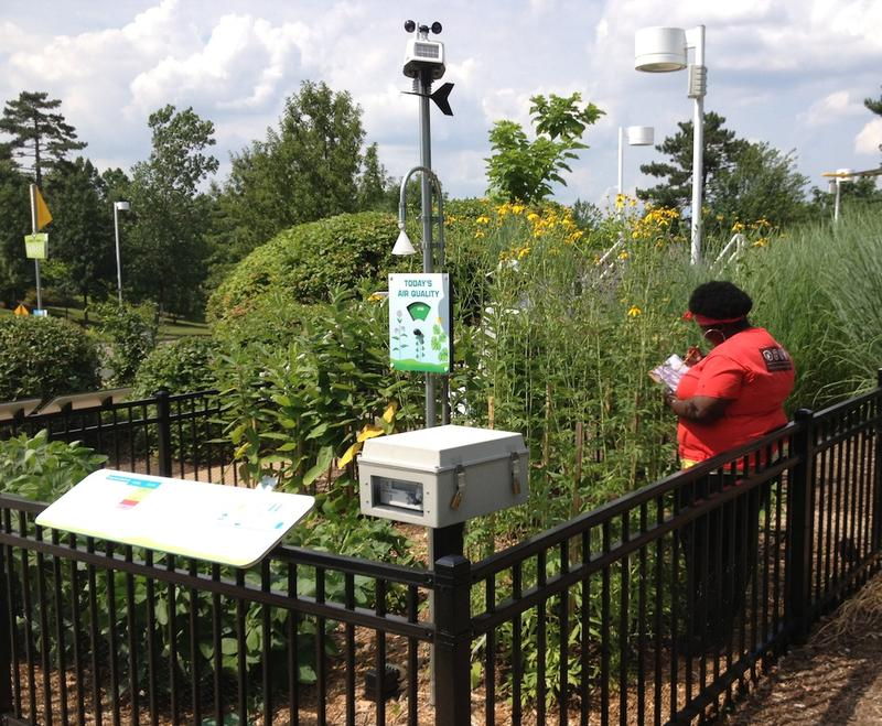 A student taking notes at the ozone garden at Saint Louis Science Center