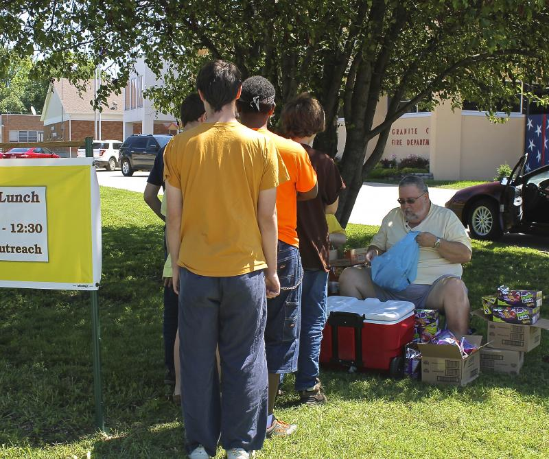 On a recent Friday, Kiki and Paul Perry gave out 137 lunches in front of the fire department.
