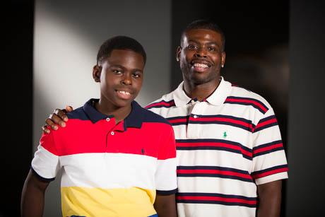 Markel Davis, 12, with his father Marvin Davis. Marvin Davis is the Fathers' Support Center's 2014 Father of the Year.