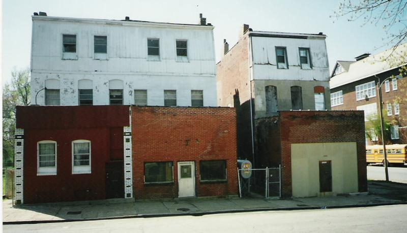 "The three buildings that made up ""Tillie's Corner"" in 2002. The building in the middle housed the grocery store."