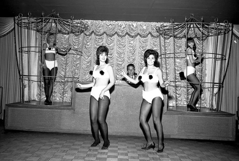 "In the mid-60s, more ""fast buck"" operators started to open clubs in Gaslight Square, eliminating the earlier coat-and-tie dress codes and bringing in go-go dancers, like these at the Gilded Cage discotheque."