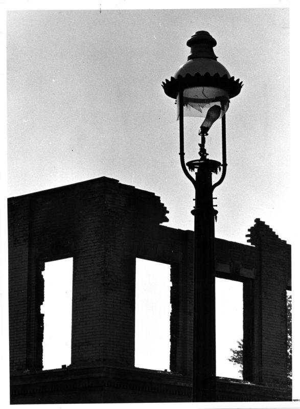 """A shattered gaslight symbolizes the deterioration of once swinging Gaslight Square,"" read the caption under this 1971 photograph in the Globe-Democrat newspaper. ""Walking in the rubble, one can only wonder: Will the area rise again?"""