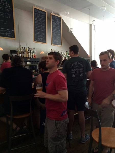 A crowd waits to order their choice of beers on tap for B33r and Brats at 33 Wine Bar for the opening event of  St. Louis Craft Beer Week on Saturday, July 26, 2014.