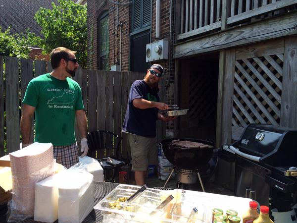 Wine distributer Eric Reed (left) and Chris McKenzie of Mac's Local Buys prepares bratwursts for B33r and Brats at 33 Wine Bar on Saturday, July 26, 2014.