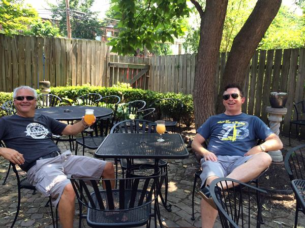 Jamie Andrews (left) and Patrick Mannies enjoy glasses of Jolly Pumpkin at 33 Wine Bar on Saturday, July 26, 2014.