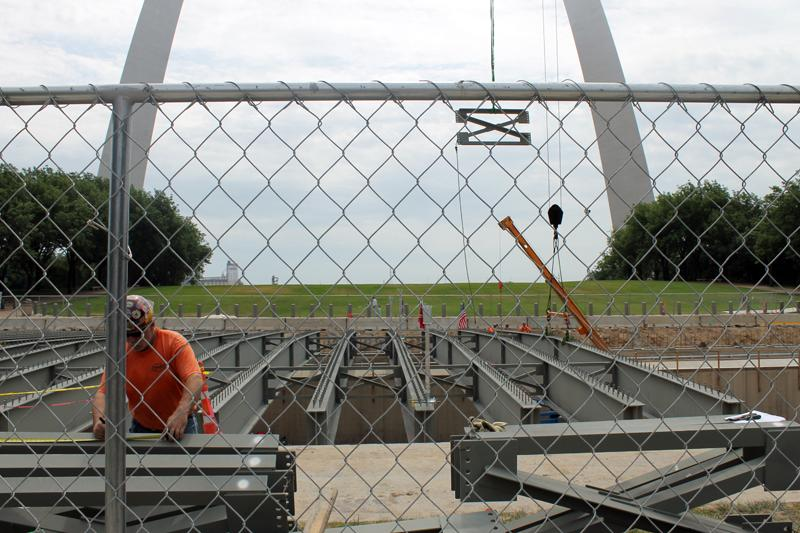 Several of the hundred-foot-long girders were already in place by Saturday, July 12, 2014. The girders will support the weight of the Park Over the Highway connecting the Old Courthouse to the arch grounds.