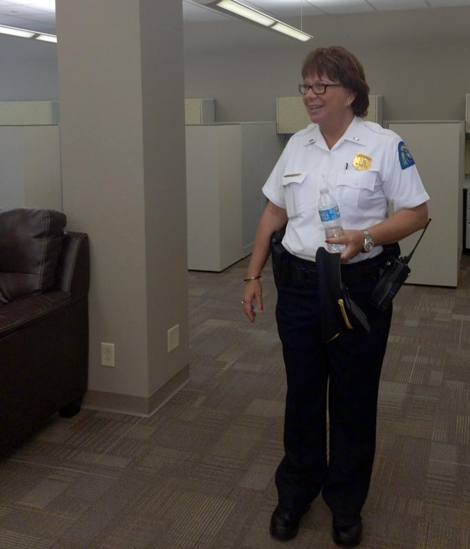 Lt. Janice Bockstock, Commander of the Juvenile Division, checks out her division's new space on Saturday, July 19, 2014.