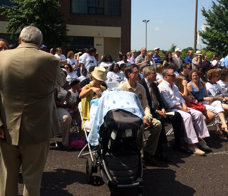 Hundreds gathered for the march and ribbon-cutting ceremony marking the opening of the new Metropolitan Police Headquarters Saturday, July 19, 2014.