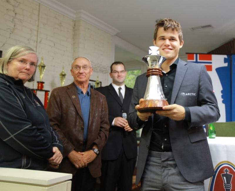 Jeanne and Rex Sinquefield presented Magnus Carlsen with the 2013 Sinquefield Cup.