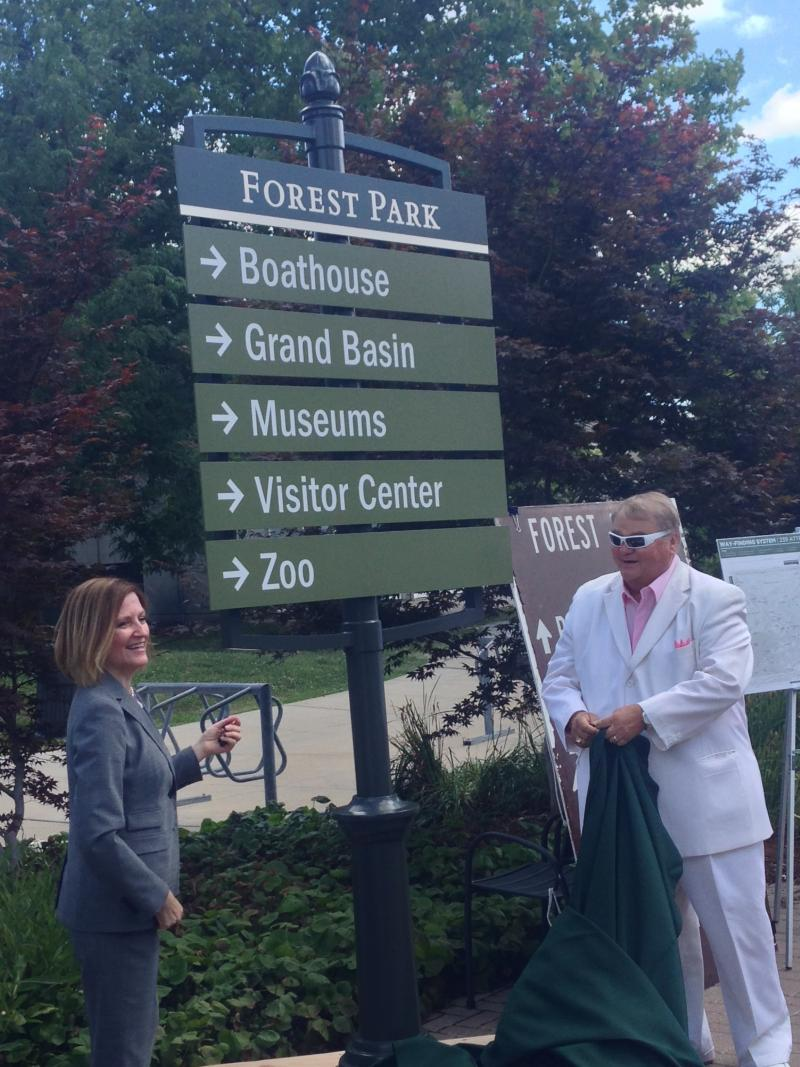 President & Executive Director of Forest Park Forever Leslie Hoffarth and Director of Parks, Recreation and Forestry Gary Bess unveil the new signs.