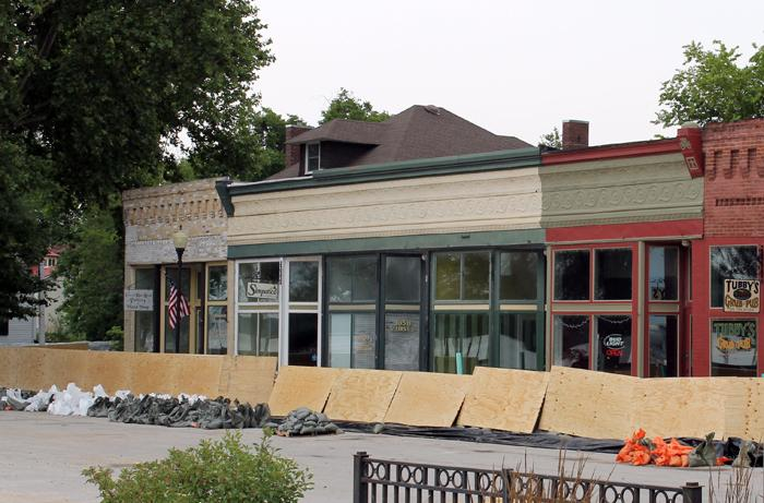 The historic business district of Clarksville, Mo. opted to add plywood to their sandbad levee.
