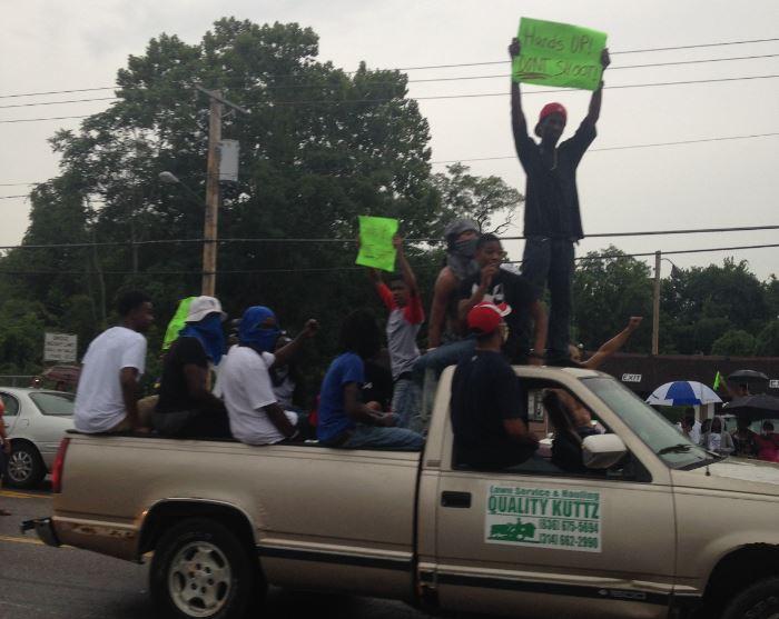 Honking cars backed up traffic along West Florissant Avenue Friday evening.