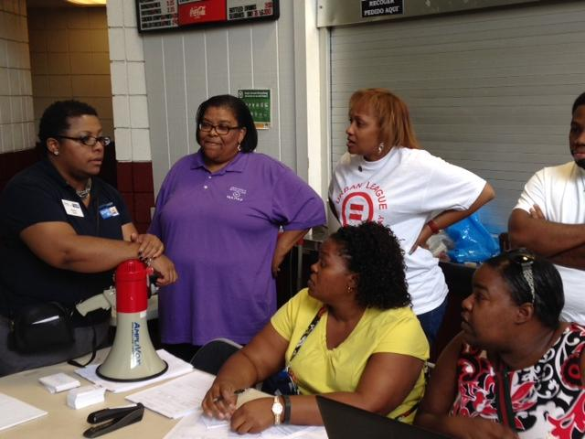 Regina Greer of the United Way Coaches volunteers at the new community resource drop-in center at the Dellwood Community Center on August 21.