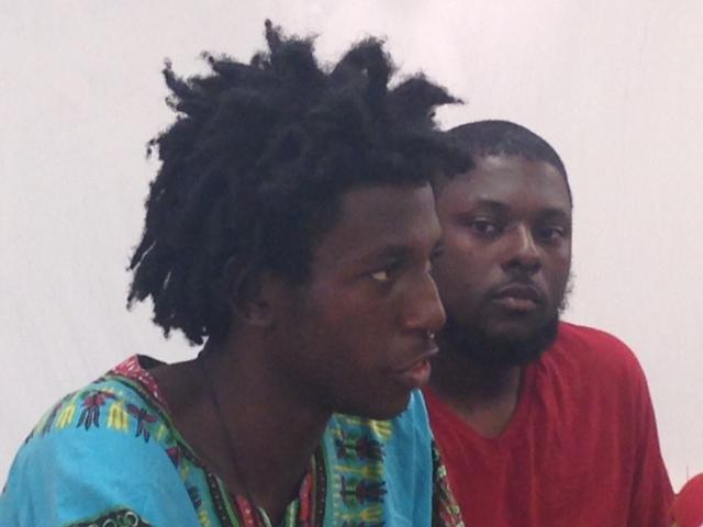 Jeffery Hill (left) and Taurean Russell speak discuss protester demands for the investigation into the shooting of 18-year-old Michael Brown.