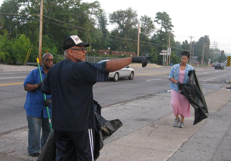 Church members pick up debris. 81914