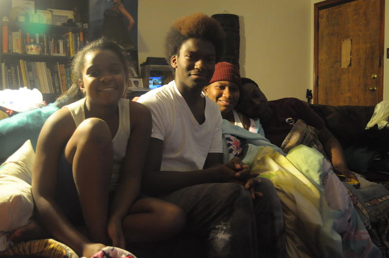 BreaDora, Marcus, theirBreaDora, Marcus, Jasmine and their mother Irma sit in their living room on August 17, 2014.  sister and their mother Irma in their living room Sunday night.