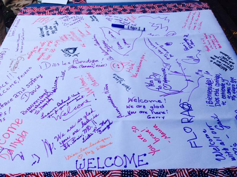 Community members signed this banner to welcome undocumented youth from Central America. If St. Louis is granted funds to house migrant children, the banner would hang in one of the facilities where the children would stay.