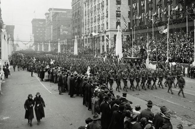 Celebrating the end of WWI, a company of the 138th Infantry marches on 12th Street (now Tucker Boulevard), May 9th, 1919.