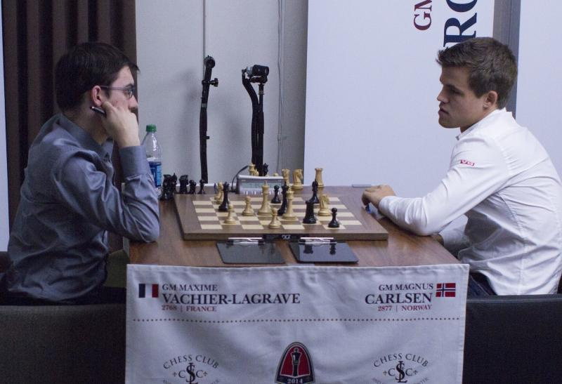 Maxime Vachier-Lagrave, left, and Magnus Carlsen played to a draw in their first game in the Sinquefield Cup.