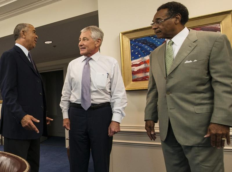 Rep. Lacy Clay, Defense Secretary Chuck Hagel and Rep. Emanuel Cleaver