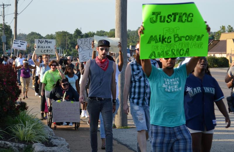 82014 Justice for Mike Brown is Justice for America, according to one of the signs Wednesday night.