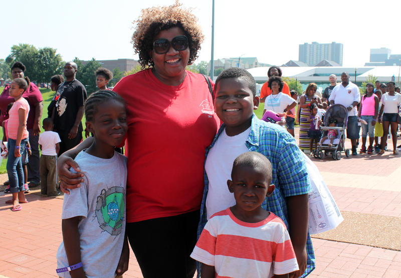 As a single parent, Lashuna Rancher was grateful for the chance to get free school supplies. She attended the fair with her son Lawayne Rancher and his friends Marcus Morgan and Ryan Harris.