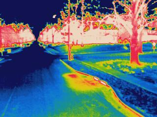 An infrared photograph shows a water main leak in Webster Groves. Water utility companies photograph roads at night to determine which pipes may be in need of repair.