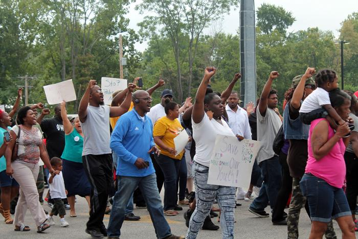 Protestors marched in the street outside the Ferguson fire department on Sunday, August 10, 2014.