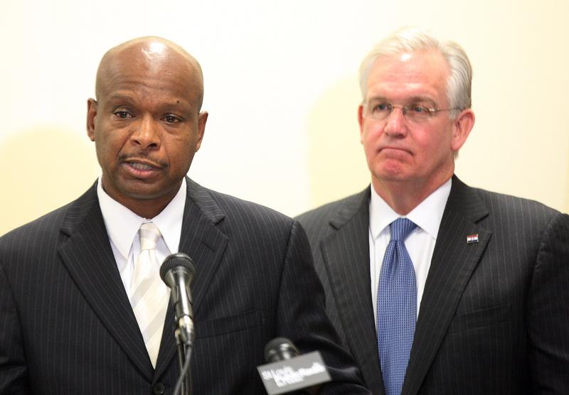Dan Isom, left, is introduced by Gov. Jay Nixon as the new Missouri public safety director.