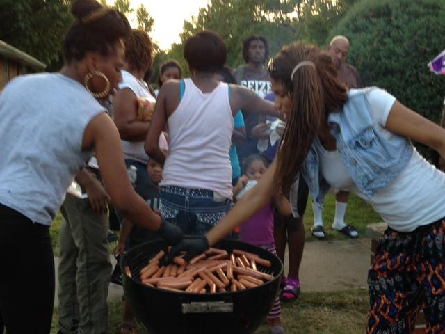 Rolanda Robinson (right) and a friend grill hot dogs for protesters on August 20 in Ferguson.