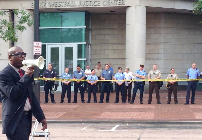 Police line the sidewalk in front of the Justice Center in Clayton Wednesday morning. 82014
