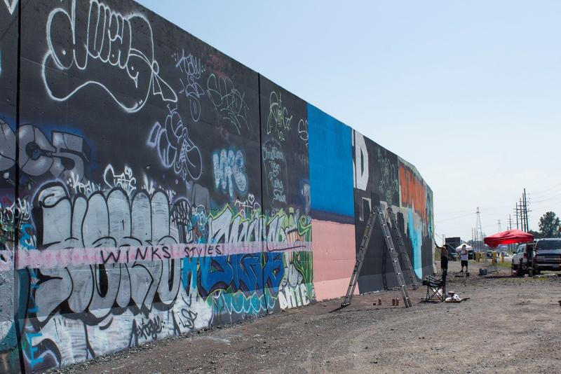 The flood wall is being prepped and will be filled with new graffiti art.