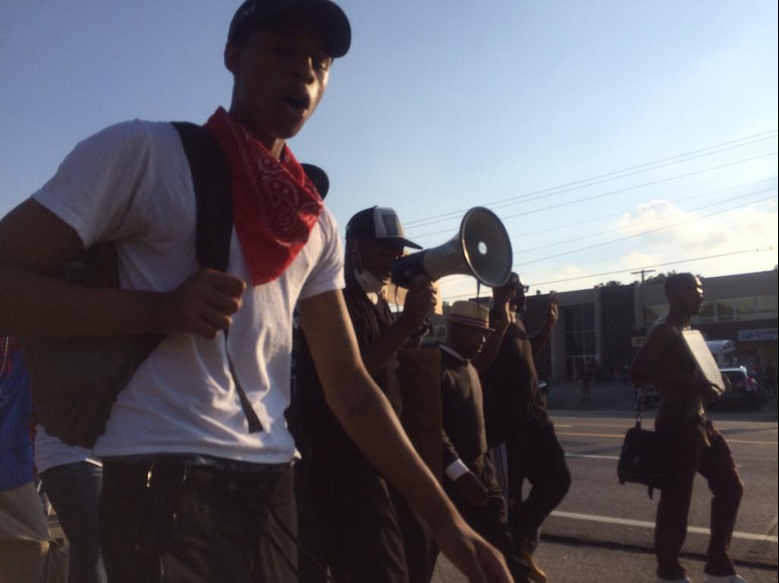 Marchers demand change on Aug. 18 in Ferguson.