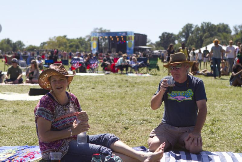 Mick Laws and Susan Warren stake out a spot with a Schlafly beer for Portugal. The Man Sunday