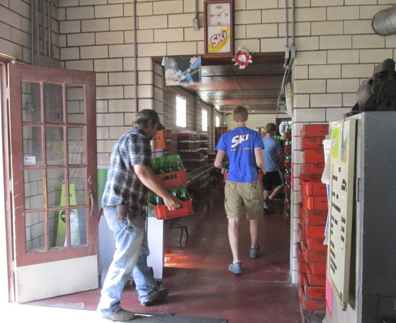 "Saturday mornings are busy, as customers return their ""empties"" and buy cases of soda at the plant."