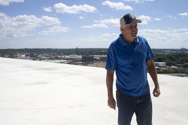 Elevator manager Brent Ricke stands on top of the grain bin deck.