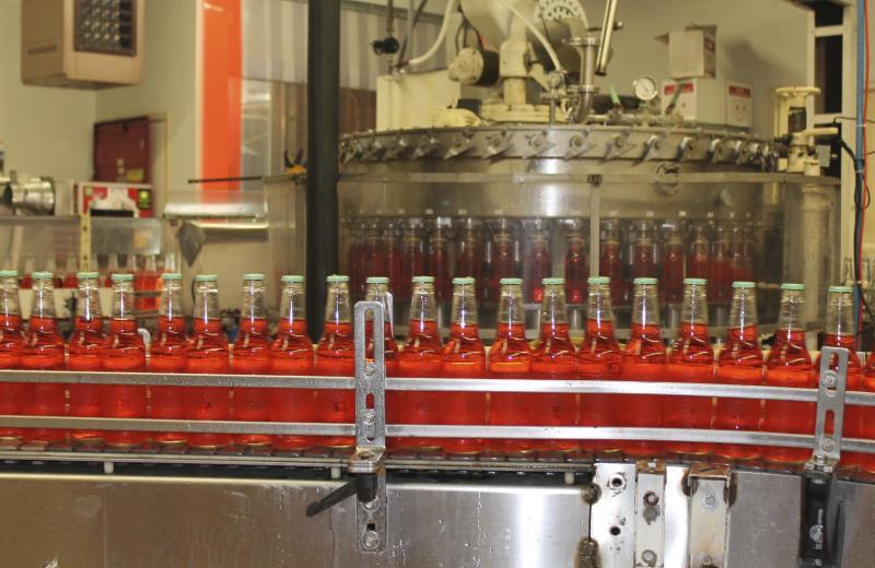 """The plant's """"new"""" 1970s-era bottling equipment fills 200 bottles a minute."""