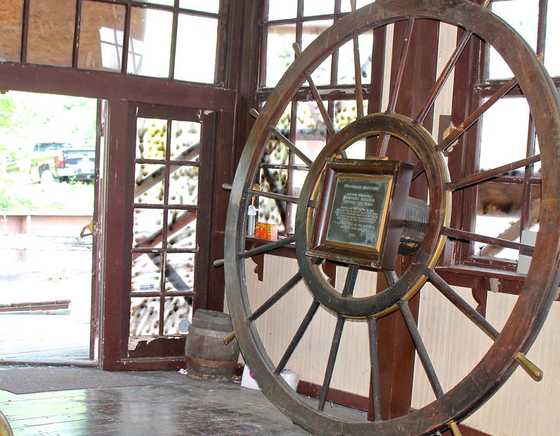 Inside the lobby is the wheel from a towboat that once pushed the Goldenrod up and down the river.